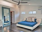 The master bedroom hosts a California king bed for restful nights of sleep!