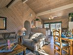 Inside, the 1,200-square-foot cottage has cathedral ceilings and homey decor.