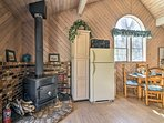 During the winter, the wood-burning stove will heat up the entire home.