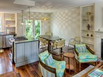 Open concept living/dining kitchen with access to courtyard