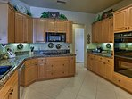 Utilize the updated appliances and granite countertops featured in the fully equipped kitchen.