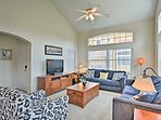 Step inside and enter the spacious living room.
