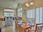 The kitchen and dining area open freely to the living room.