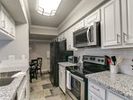 Bright open kitchen with granite countertops and  new appliances