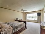 This room has beautiful lake views and a cozy queen bed.