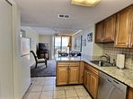 Kitchen with granite counters, tiled backsplash and all appliances