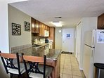 Kitchen with granite counters and breakfast bar for 2
