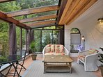 Warm and cozy sunroom next to the gardens
