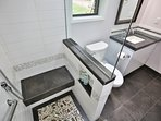 Two person shower with dual heads and bench