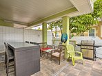 The covered patio offers ample seating and a gas grill!