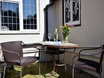 Enjoy a glass of wine in the courtyard area
