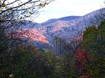 Gaze out at the Maggie Valley hills from the top-floor deck!