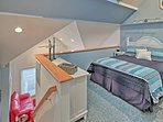 Climb up to the loft area where 2 guests can cozy up in this queen mattress.