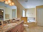 The master bath offers a soaking tub.