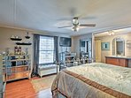 The master bedroom includes all of the amenities of home and a queen-sized bed.