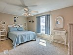 This dreamy bedroom will lull you into a peaceful sleep in its full-sized bed.