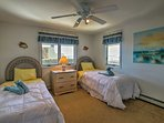 Youngsters can cozy up in one of the 2 twin beds in this 4th bedroom.