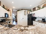 Beautiful granite work tops with a full equipped kitchen
