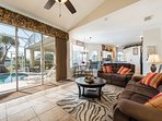 Living area with triple patio doors onto the pool deck