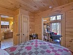 The bedroom is embellished with natural wood furnishings.