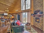 Stay warm in front of the stacked stone fireplace.