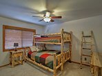 Find a twin XL-over-queen bunk bed in this second bedroom.