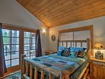 This first bedroom includes a queen bed and french doors to access the patio.