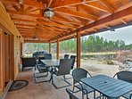 Host a cookout on the covered patio featuring a Pro Series grill.