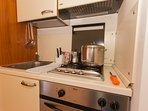 Kitchenette with cooker hob, fridge and freezer oven