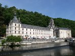 Brantome with its magnificent abbey, river, shops and houses built into the rock, an hour away