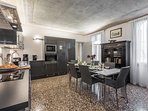 Terrazzo Veneziano flooring, frescoed ceiling, antique furniture and high tech kitchen