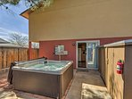 A private backyard lets you soak in the 6-person hot tub in peace.