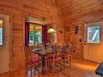 The interior is covered in beautiful wood floors, walls and ceilings.