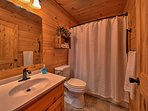 Freshen up in this full bathroom and get ready for the day.