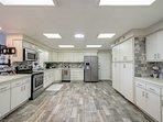 New flooring, bright open beachy kitchen.  Stainless Steel modern appliances.