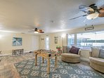 Living Room that faces water view.  Open, Light Bright.  Those chairs turn 360 degrees.