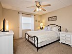 Warm and inviting master bedroom with queen size bed.
