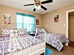 Vibrant decor makes this guest room fun for all.