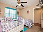 Guest room features a queen bed, full bed, ceiling fan and flat screen TV.