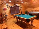 Loft is a game room with air hockey, pool table, and table and chairs