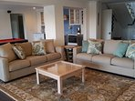 Family room has 60' smart TV with XBox One gaming system and collection of videogames.