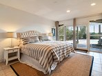 King master bedroom #5 has private bath, pool patio access and 40' smart TV