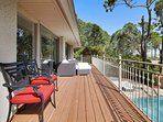 Rear of home has full length deck with seating for 6 people