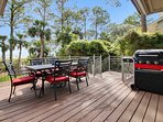 Deck off kitchen has propane grill and table that seats 6-8 people