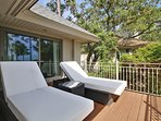 King master bedroom #1 has cushioned lounge chairs on private deck