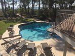 ...and a 2 person bistro table to the left of the loungers completes your pool area seating options.