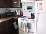 Kitchen has full sized F/S and many small appliances