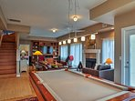 Shoot some billiards downstairs on the pool table.