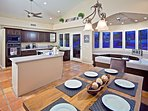 Large kitchen with dining area and wine cooler.