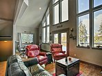 Lofty ceilings and high windows create an airy living space.